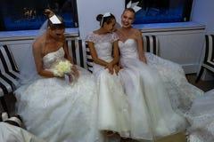 NEW YORK, NY - OCTOBER 13: Models make informal modeling at the Carolina Herrera Bridal Presentation Stock Image