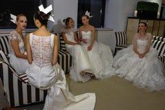 NEW YORK, NY - OCTOBER 13: Models make informal modeling at the Carolina Herrera Bridal Presentation Stock Photos