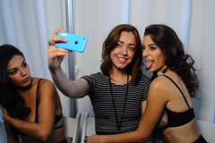 NEW YORK, NY - OCTOBER 25: Models making selfie snapshots backstage during Made in the USA Spring 2015 lingerie Royalty Free Stock Photo
