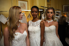 NEW YORK, NY - OCTOBER 09: Models posing  backstage wearing Oleg Cassini Fall 2015 Bridal collection Royalty Free Stock Photos