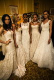 NEW YORK, NY - OCTOBER 09: Models posing backstage wearing Oleg Cassini Fall 2015 Bridal collection. At the Plaza Athenee on October 09, 2014 in New York City royalty free stock photography
