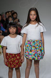 NEW YORK, NY - OCTOBER 19: Models walk the runway during the Aria Children's Clothing preview at petitePARADE Kids Fashion Week Royalty Free Stock Photography