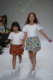 NEW YORK, NY - OCTOBER 19: Models walk the runway during the Aria Children's Clothing preview at petitePARADE Kids Fashion Week Royalty Free Stock Images