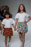NEW YORK, NY - OCTOBER 19: Models walk the runway during the Aria Children's Clothing preview at petitePARADE Kids Fashion Week Stock Image