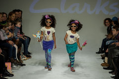 NEW YORK, NY - OCTOBER 19: Models walk the runway during the Clarks preview. At petitePARADE Kids Fashion Week at Bathhouse Studios on October 19, 2014 in New Royalty Free Stock Photos