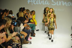 NEW YORK, NY - OCTOBER 18: Models walk the runway finale during the Alivia Simone preview at petite PARADE Kids Fashion Week Royalty Free Stock Photography