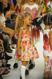 NEW YORK, NY - OCTOBER 18: Models walk the runway finale during the Alivia Simone preview at petite PARADE Kids Fashion Week Royalty Free Stock Photo