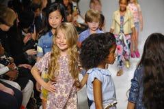 NEW YORK, NY - OCTOBER 18: Models walk the runway finale  during the Anasai preview at petitePARADE Kids Fashion Week Royalty Free Stock Images
