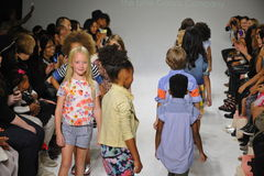 NEW YORK, NY - OCTOBER 18: Models walk the runway finale  during the Anasai preview at petitePARADE Kids Fashion Week Stock Photos