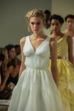 NEW YORK, NY - OCTOBER 09: Models walk the runway finale at the Della Giovanna Bridal Runway Show during Fall 2015 Bridal. Collection at the Alhemical on stock photo