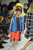 NEW YORK, NY - OCTOBER 18: Models walk the runway finale during the Parsons preview at petite PARADE Kids Fashion Week Royalty Free Stock Photos