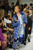 NEW YORK, NY - OCTOBER 18: Models walk the runway finale during the Parsons preview at petite PARADE Kids Fashion Week Royalty Free Stock Image