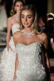 NEW YORK, NY - OCTOBER 09: Models walk the runway finale wearing Oleg Cassini Fall 2015 Bridal collection Royalty Free Stock Image