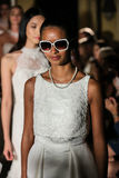 NEW YORK, NY - OCTOBER 09: Models walk the runway finale wearing Oleg Cassini Fall 2015 Bridal collection. At the Plaza Athenee on October 09, 2014 in New York royalty free stock image