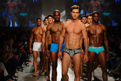 NEW YORK, NY - OCTOBER 21: Models walk the runway finale during 2(X)IST Men's fashion show Stock Image