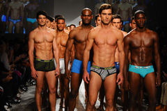 NEW YORK, NY - OCTOBER 21: Models walk the runway finale during 2(X)IST Men's fashion show Royalty Free Stock Photo