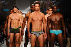 NEW YORK, NY - OCTOBER 21: Models walk the runway finale during 2(X)IST Men's fashion show Stock Photography
