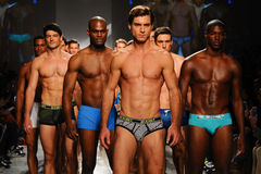 NEW YORK, NY - OCTOBER 21: Models walk the runway finale during 2(X)IST Men's fashion show Royalty Free Stock Image