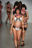 NEW YORK, NY - OCTOBER 25:  Pregnant models walk runway finale during You! Lingerie Spring 2015 show Stock Images