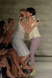 NEW YORK, NY - SEPTEMBER 06: Actress Kelly Rutherford and designer Son Jung Wan embrace on the runway Stock Photos