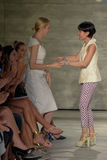 NEW YORK, NY - SEPTEMBER 06: Actress Kelly Rutherford and designer Son Jung Wan embrace on the runway Stock Photo