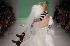 NEW YORK, NY - SEPTEMBER 10: Designer Betsey Johnson is carried off the runway by model Drag Queen Sharon Needles Stock Photography