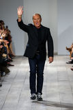 NEW YORK, NY - SEPTEMBER 10: Michael Kors greets the audience after presenting his Michael Kors Spring 2015 Collection Royalty Free Stock Image