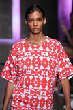 NEW YORK, NY - SEPTEMBER 07: Model Cora Emmanuel walks the runway at DKNY Spring 2015 fashion collection Royalty Free Stock Photo