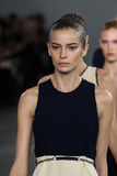 NEW YORK, NY - SEPTEMBER 11: Model Dasha Denisenko walks the runway at the Calvin Klein Collection fashion show Stock Photo