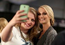 NEW YORK, NY - SEPTEMBER 06: Model Elena Kurnosova (R) backstage at Venexiana Royalty Free Stock Image