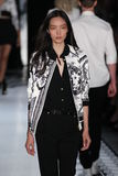 NEW YORK, NY - SEPTEMBER 07: Model Fei Fei Sun walks the runway at the Versus Versace Spring 2015 Collection Royalty Free Stock Images