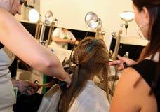 NEW YORK, NY - SEPTEMBER 06: A model has her hair done backstage at Venexiana Stock Photos