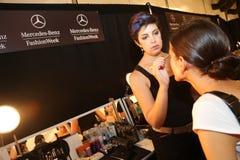 NEW YORK, NY - SEPTEMBER 06: A model has her make-up done backstage at Venexiana Stock Photos