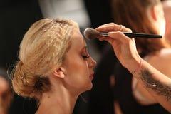 NEW YORK, NY - SEPTEMBER 06: A model has her make-up done backstage at Venexiana Stock Image