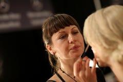 NEW YORK, NY - SEPTEMBER 06: A model has her make-up done backstage at Venexiana Stock Photo