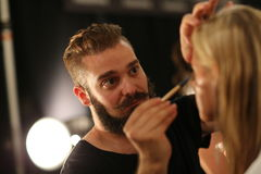 NEW YORK, NY - SEPTEMBER 06: A model has her make-up done backstage at Venexiana Royalty Free Stock Image