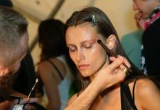 NEW YORK, NY - SEPTEMBER 06: A model has her make-up done backstage at Venexiana Royalty Free Stock Photo