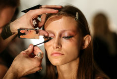 NEW YORK, NY - SEPTEMBER 06: A model has her make-up done backstage at Venexiana Stock Image