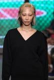 NEW YORK, NY - SEPTEMBER 07: Model Soo Joo Park walks the runway at DKNY Spring 2015 fashion collection Stock Images