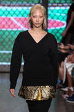 NEW YORK, NY - SEPTEMBER 07: Model Soo Joo Park walks the runway at DKNY Spring 2015 fashion collection Stock Images