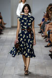NEW YORK, NY - SEPTEMBER 10: A model walks the runway at Michael Kors Spring 2015 fashion collection Royalty Free Stock Photo