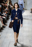 NEW YORK, NY - SEPTEMBER 10: A model walks the runway at Michael Kors Spring 2015 fashion collection Stock Photography