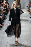 NEW YORK, NY - SEPTEMBER 10: A model walks the runway at Michael Kors Spring 2015 fashion collection Royalty Free Stock Image