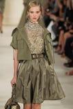 NEW YORK, NY - SEPTEMBER 11: A model walks the runway at Ralph Lauren Spring 2015 fashion collection Imagen de archivo