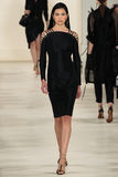NEW YORK, NY - SEPTEMBER 11: A model walks the runway at Ralph Lauren Spring 2015 fashion collection Imagenes de archivo