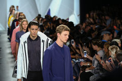 NEW YORK, NY - SEPTEMBER 06: Models walk the runway finale at Lacoste Spring 2015 fashion show Royalty Free Stock Image