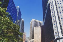 Lower Manhattan street with skyscrapers and historic buildings Royalty Free Stock Photo