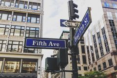 5th Avenue east 37th street road sign in Manhattan with building Stock Image