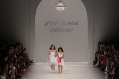 NEW YORK, NY - SEPTEMBER 10: Two children models walk the runway at Betsey Johnson Spring 2015 fashion show Stock Photo