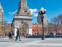 New York, NY/United States-=Feb. 22, 2016: Winter at Washington. Square Park. A view of the Washington Square Arch and park goers stock image